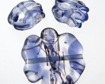 Lampwork sculpted bead set in clear, purple, and black