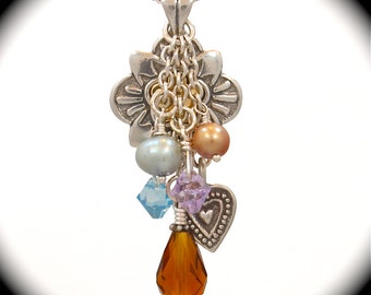 Long sterling heart charm necklace with pearls, Swarovski crystals and sterling charms.