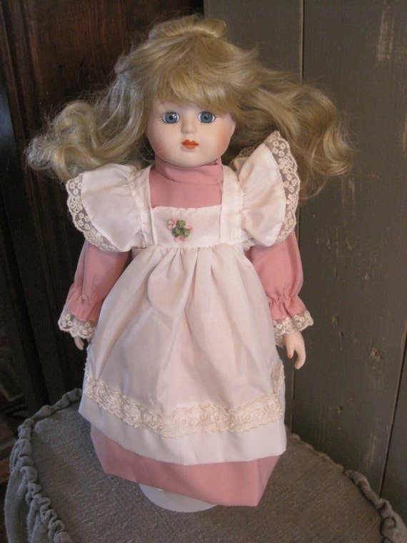 Vintage Porcelain Doll In Dress Apron And Soft Shoes With A