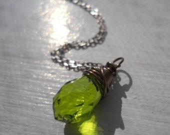 Olive  green teardrop crystal briolette, Industrial chic, wire wrapped in the gunmetal finish.