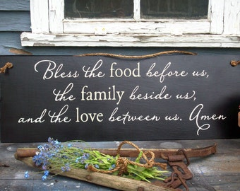 Bless the food before us, the family beside us, and the love between us. Amen, wood sign