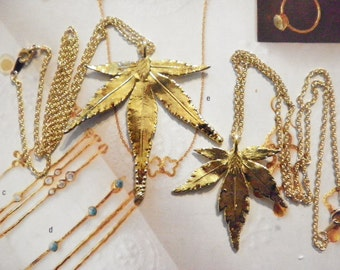 1 Set of Goldplated Original 60s His and Her's Marijuana Leaf Necklaces