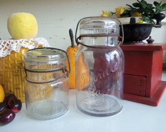 2 Vintage Clear Double Safety Quart and Pint Sized Jars with Wire Bails and Glass Lids  B668