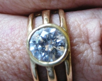 Engagement ring. For A. Gold coloured ring. Solitaire Cubic zirconia engagement  ring set in brass