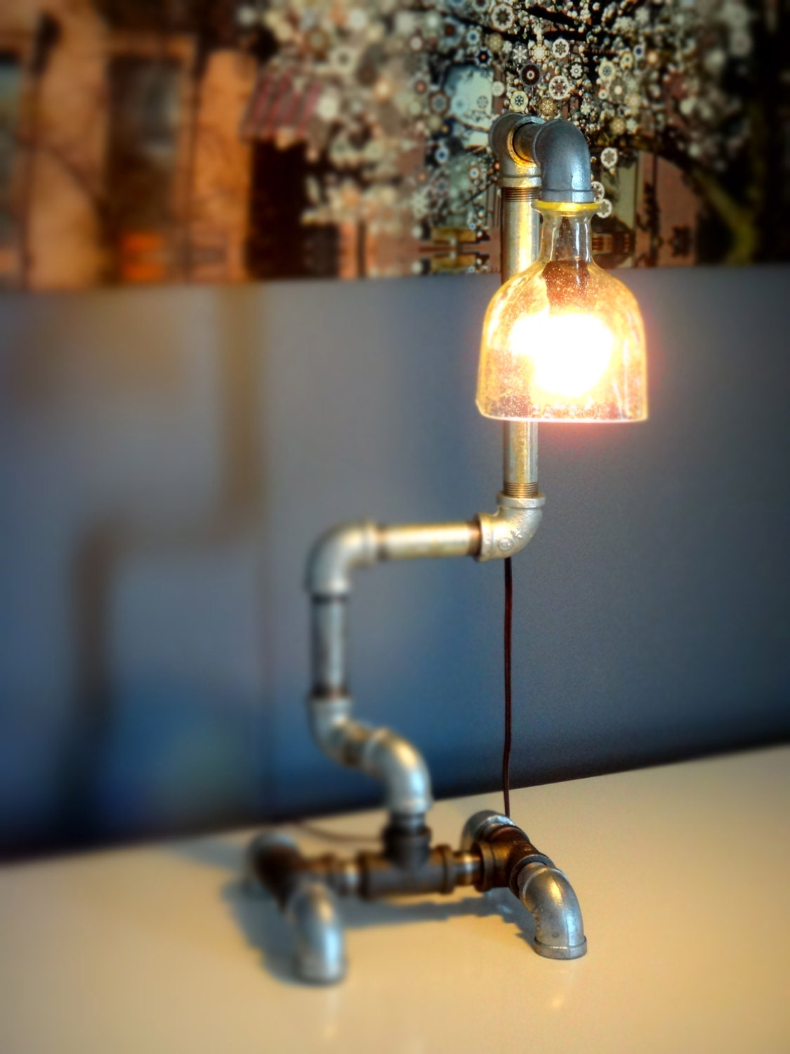 Industrial pipe lamp patron tequila bottle steel pipe table for Industrial pipe light socket