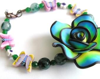 Unique Polymer Clay Flower & Butterfly Bracelet w/ Emeralds- 8 inch bracelet