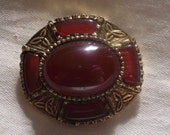 vintage celtic style gold tone and dark red stone brooch