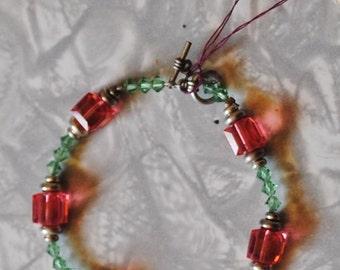 Padparadscha and erinite bracelet (#1)