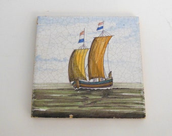 Vintage tile with a  ship flying the Netherlands flag portrayed on front of tile