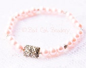 Pink Pearl Bead Stretch Stack Bracelet with Silver Floral Focal Bead