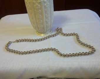 Fun and Vintage silver tone metal necklace with silver metal beads