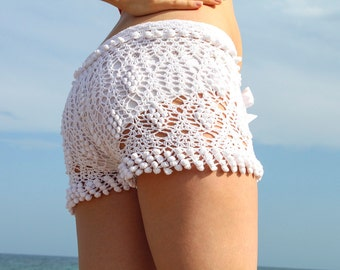 Exclusive white crochet beach shorts