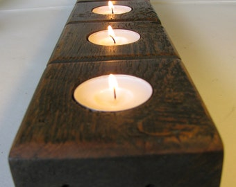 Rustic wood candle holder.