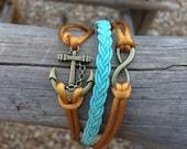 Three-piece Anchor, Infinity Symbol and braided bracelet.