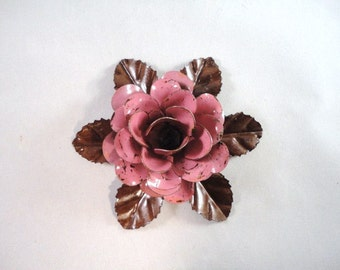 Medium Size Decorative Metal Hand Cut and Hand Painted Rustic Pink Rose Mounted on a Bed of Metal Leaves.