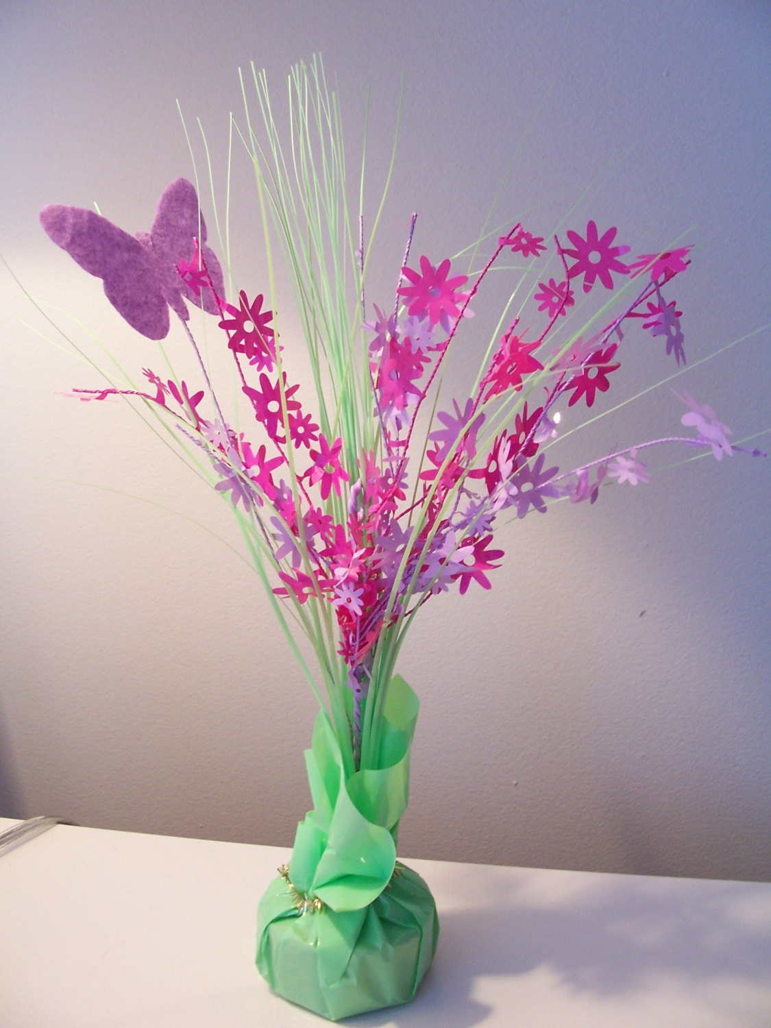 Colourful butterfly table center piece by sparkleandcomfort