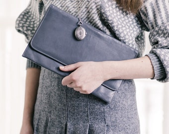 An Oversized fake leather vintage grey clutch by PERSAUD of London