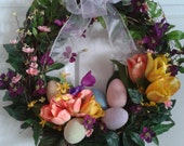 Easter wreath with tulips and frosted pastel Easter eggs