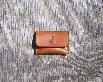 Leather Coin Pouch or pill pouch with stud closure in light Java brown.  3 x 2 inches in Full Grain Veg Tan leather handmade in the USA.