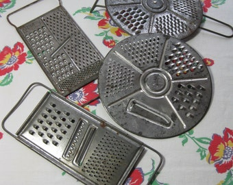 Four Vintage Rusty Metal Graters