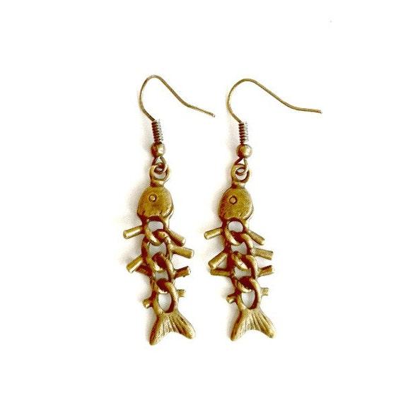 Items similar to fish bones earrings steampunk fishbone for Fish bone earrings