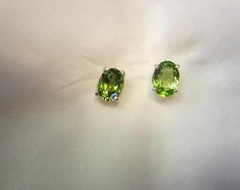 Beautiful Pair of Oval Peridot Stud earrings.
