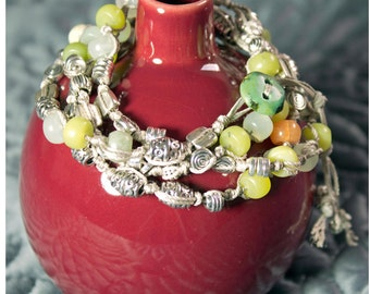 SALE now 50 was 60.  Wrap Bracelet Handknotted beads & stones