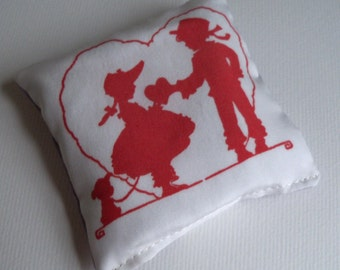 Lavender sachet on silk fabric with vintage boy and girl illustration