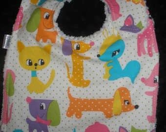 Toddler size side snapping bib in Girl Plush Puppies by Michael Miller print