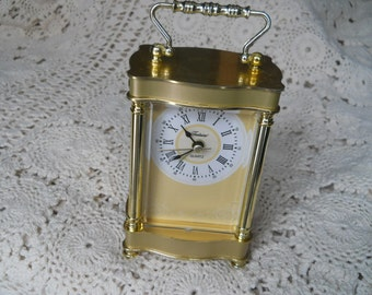 vintage Fontaine clock 7 inches tall