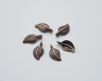 10 Pcs. charms/ metal pendants small leaf / antique copper tone A017