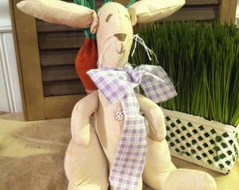 Primitive Country Easter Bunny with large carrot on his back and moveable arms and legs