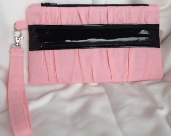 Pink gathered clutch purse with patent black band