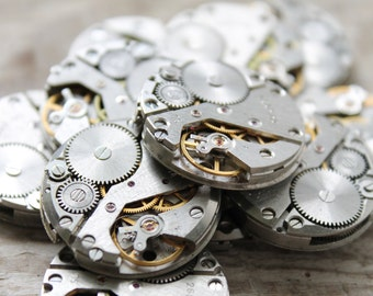 "1"" ... 12  identical  vintage rectangular watch movements"