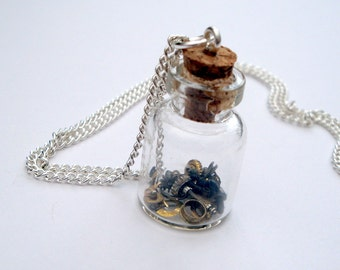 Steampunk necklace - bottle of vintage watch parts, cogs and gears
