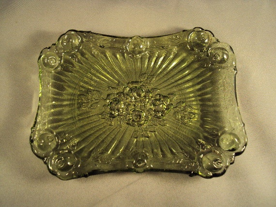 A vintage Fenton glass rose soap dish in olive green