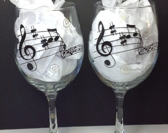 Music Wine glass. Musical notes