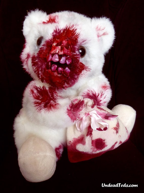 UnDeadTed with chewed-off face and a little blood-soaked bag containing who knows what