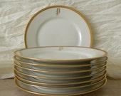 French Limoges gold-rimmed monogrammed side plates
