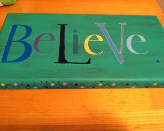 Hand-painted Believe wooden sign