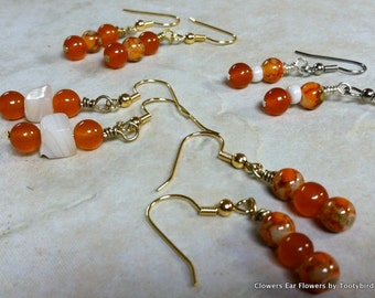 Orange beads, solid or speckled, and/or white stone or bead on ear wires