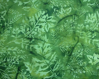 Bold green batik accented with lighter green.