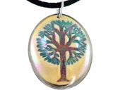 Tree of Life porcelain pendant, hand painted in earth tones & summer green, trimmed in 22K gold or platinum, with custom black satin cord.