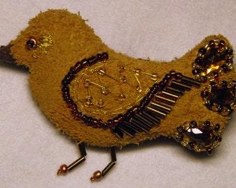 Brooch-a bird of artificial suede