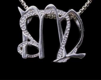 44 Leo and Virgo Silver Unity Pendant