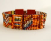 Beaded geometric bracelet, red orange leather, copper tube clasp, red orange blue, beadweaving, friendship, seed bead bracelet MADE TO ORDER