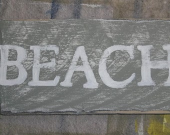 small hand painted beach sign