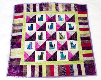 Baby girl patchwork applique quilt with amusing batik cats