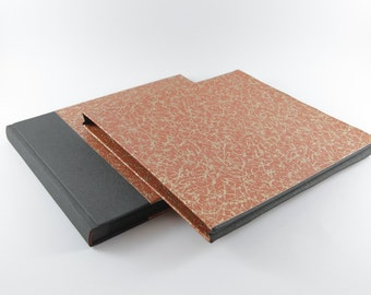 Brick red and gold handcrafted photo album in a case