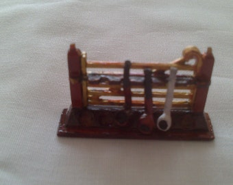 12th Scale dolls house pipe rack with 3 separate pipes